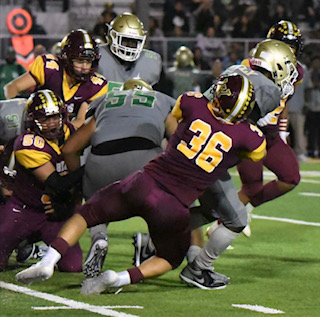 Dowgiewicz, number 36, tackles a Cabrillo player at Wilson's away game 09/27/19