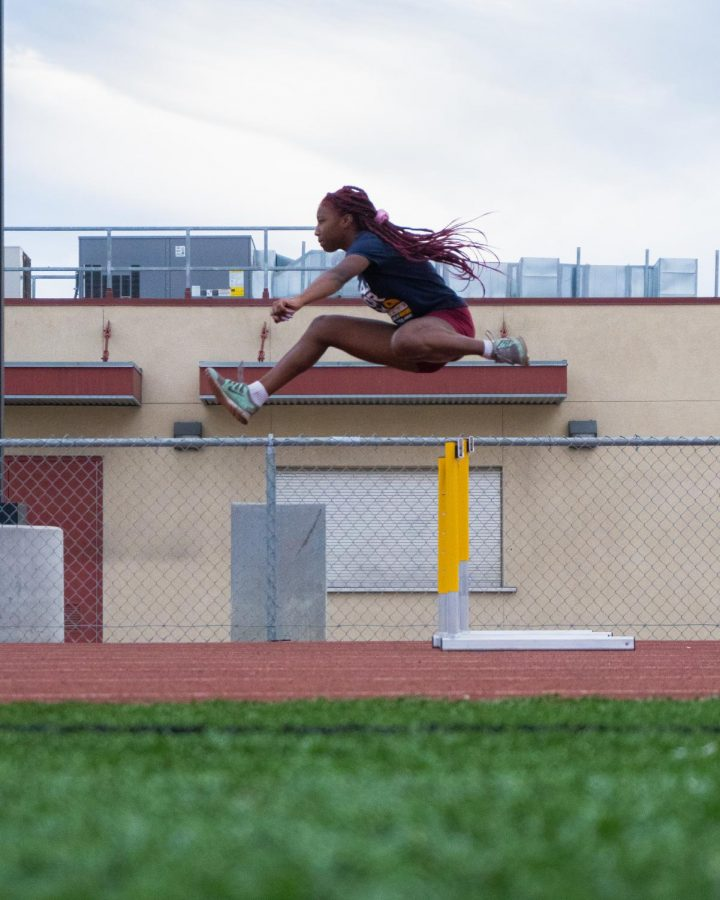 Trinity Moseby 11th Track and Field running hurdles.